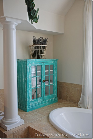 Using a hutch cabinet for added bathroom storage