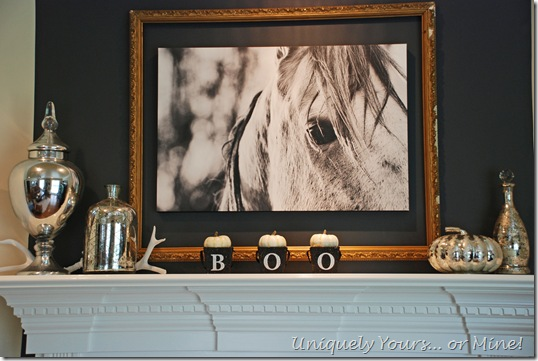 Updated firplace wall in family room, horse art, painted brick