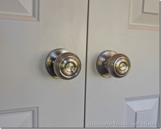 changing out brass doorknobs for nickel knobs