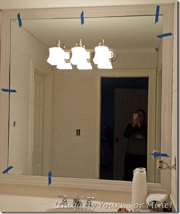 Installing a frame around a bathroom mirror
