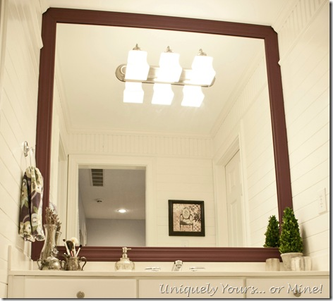 Installing a frame around a bathroom mirror