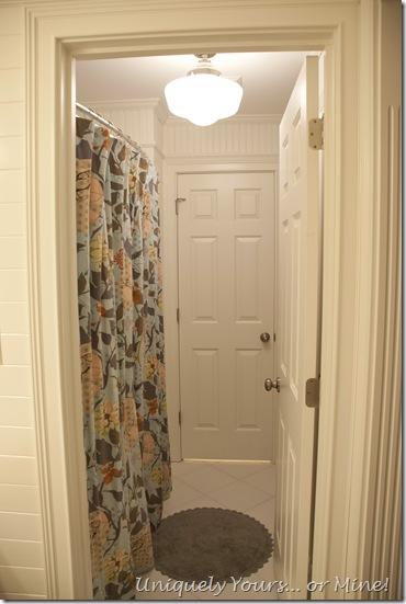 Custom shower curtain in tub area