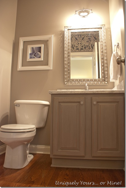 Gray painted powder room with stenciled walls