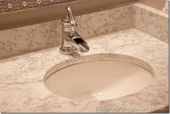 Gray & white marble vanity top with pump style faucet