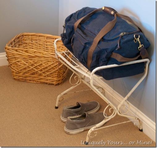 vintage wrought iron ottoman as luggage rack