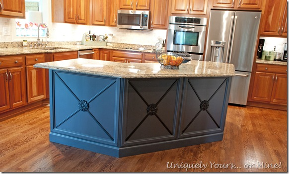 Gray black painted kitchen island with added molding