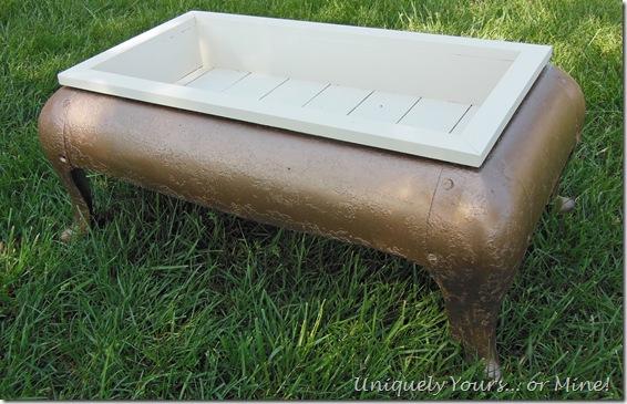 upcycled antique iron stove base into planter