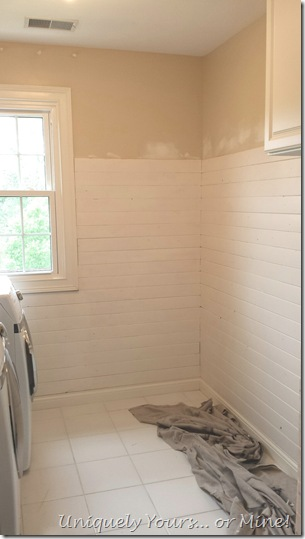 Adding v-groove wood planks to laundry room walls