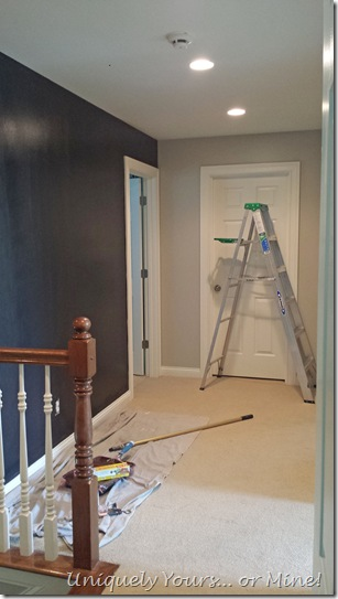Hallway with black accent wall