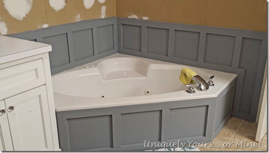 Installing wainscoting around bathtub in master bathroom