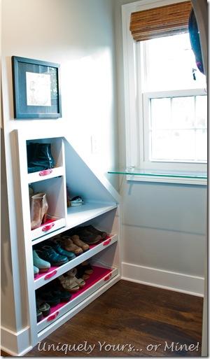Dormer window space built in shoe shelves in knee wall