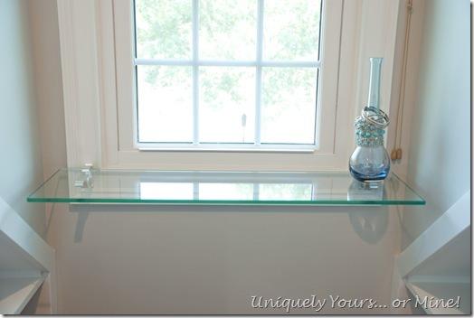 Floating glass shelf in dormer window area