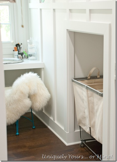 Built in laundry basket space in knee wall