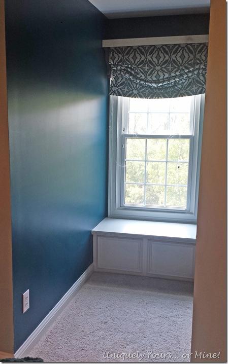 Dark teal painted dormer window
