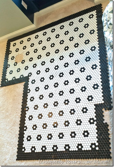 Dry layout of black and white mosaic tiles with flowers