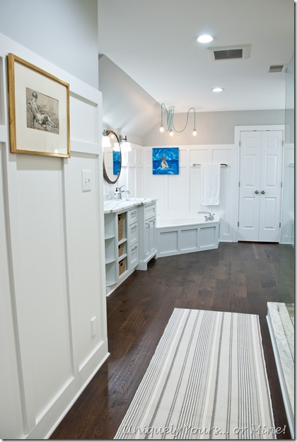 Master bathroom renovation in shades of grey and white, with engineered hardwood flooring