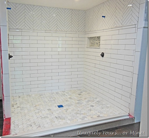 Tiling master bathroom shower, herringbone subway and carrera marble