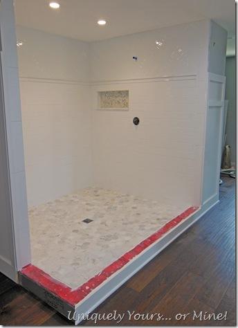 Tiling master bathroom shower, herringbone subway and carrera marble