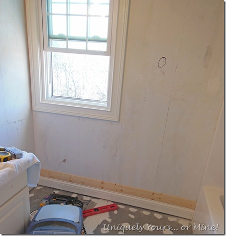 installing wood wall planks in bathroom