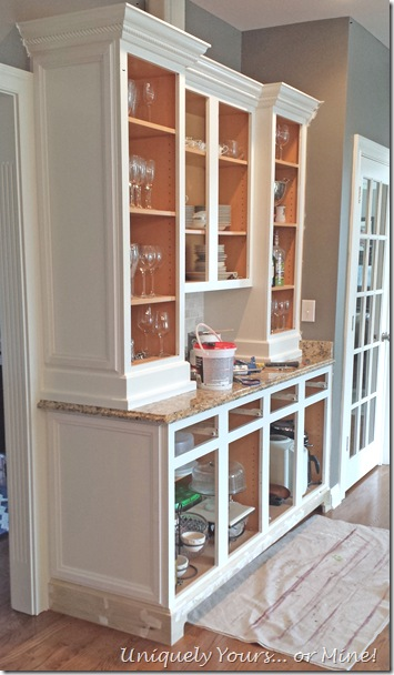 adding feet and decorative molding to cabinets