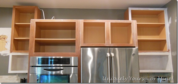 Raising kitchen cabinets and adding open cabinets below