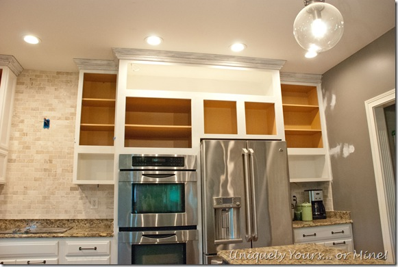 Kitchen cabinets painted and raised to ceiling