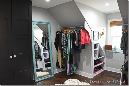 Slanted ceiling hanging space in renovated closet turned dressing room