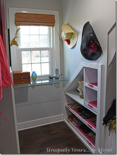 Custom built-in shoe shelves in renovated closet turned dressing room