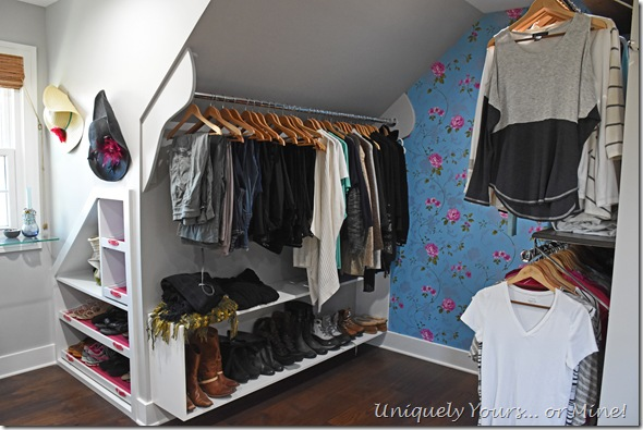 Slanted ceiling clothes hanging space in renovated closet turned dressing room