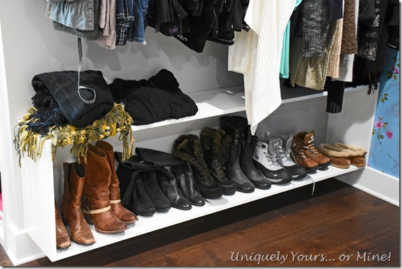 Custom hanging boot cabinet in renovated closet turned dressing room
